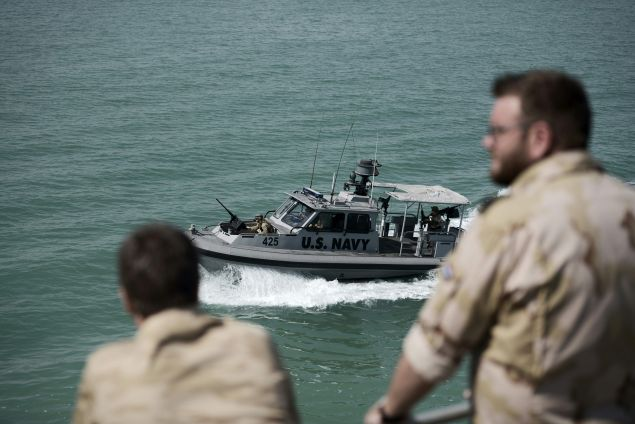 Navy sailors from The Netherlands watch training exercises from aboard the Choctaw County, a new U.S. Navy non-combatant vessel that has a civilian crew to provide maritime security, crisis response and troop transport, in the Gulf off the coast of Bahrain's capital Manama on April 10, 2016 The Bahrain-based U.S. Naval Forces Central Command is leading the International Mine Countermeasures Exercise (IMCMEX). / AFP / MOHAMMED AL-SHAIKH (Photo credit should read MOHAMMED AL-SHAIKH/AFP/Getty Images)