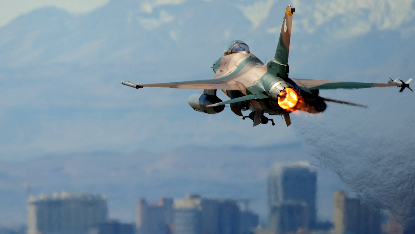 NELLIS AIR FORCE BASE, NEV. -- An F-16 Aggressor takes off from the Nellis flight line during a Red Flag Exercise, March 3, 2010. Red Flag is a realistic combat training exercise involving the air forces of the United States and its allies. The exercise is conducted on the 15,000-square-mile Nevada Test and Training Range, north of Las Vegas.   (U.S. Air Force Photo by Staff Sgt. William P. Coleman/RELEASED)