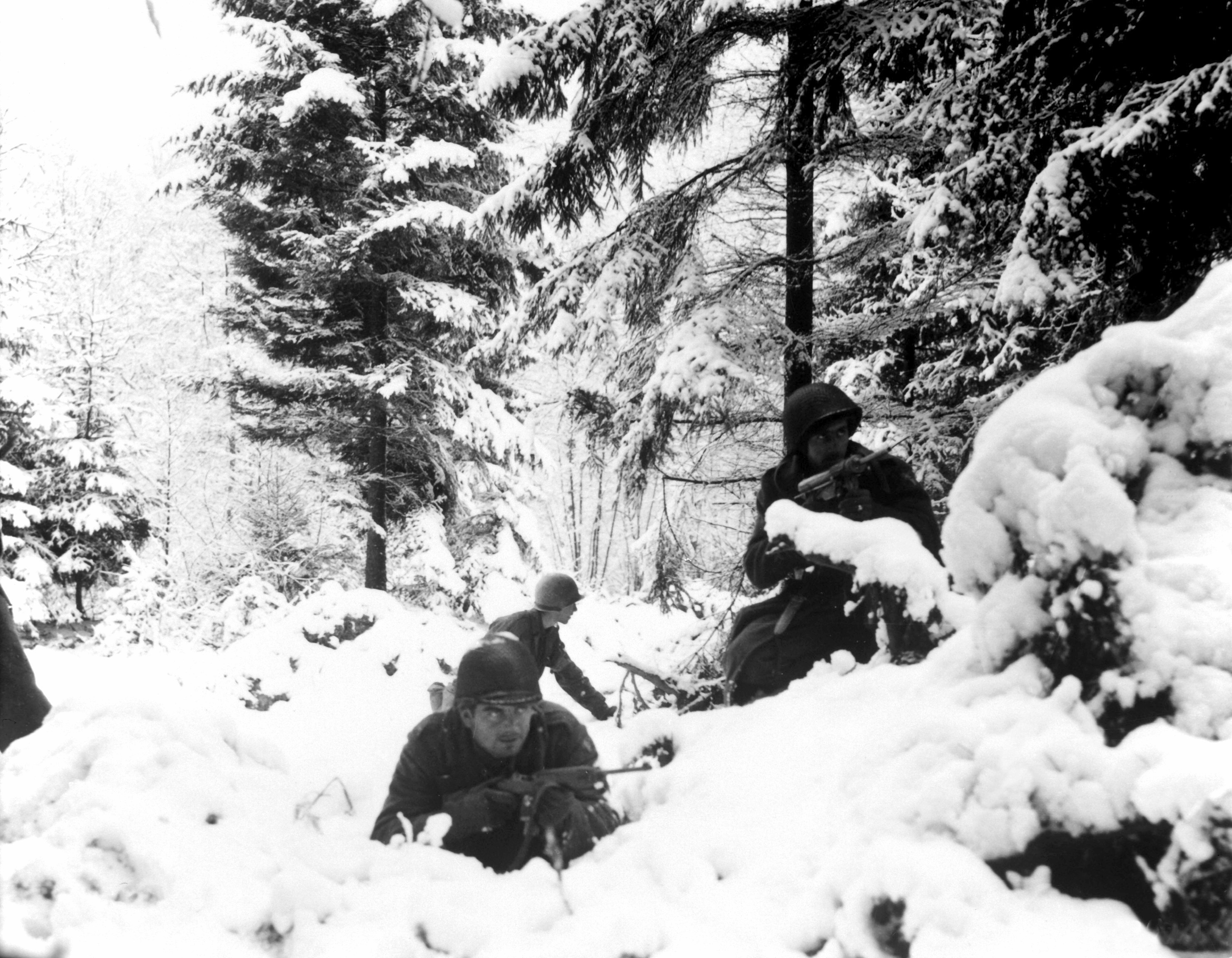 American infantrymen of the 290th Regiment fight in fresh snowfall near Amonines, Belgium.  January 4, 1945.  Braun.  (Army) NARA FILE #:  111-SC-198534 WAR & CONFLICT BOOK #:  1077