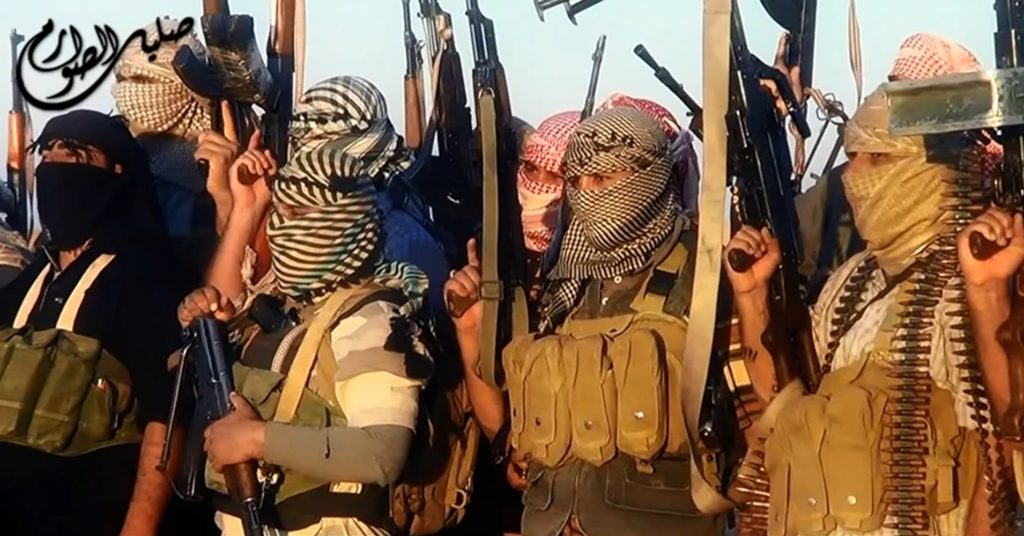 """An image grab taken from a propaganda video uploaded on June 8, 2014, by the jihadist group the Islamic State of Iraq and the Levant (ISIL) allegedly shows ISIL militants near the central Iraqi city of Tikrit. Militants battled Iraqi security forces in Tikrit on June 11, 2014, after jihadists seized a swathe of the north, including second city Mosul, officials said. Heavy clashes rocked the north of Tikrit, hometown of now executed dictator Saddam Hussein, a provincial councillor said. AFP PHOTO / HO / ISIL == RESTRICTED TO EDITORIAL USE - MANDATORY CREDIT """"AFP PHOTO / HO / ISIL"""" - NO MARKETING NO ADVERTISING CAMPAIGNS - DISTRIBUTED AS A SERVICE TO CLIENTS ===-/AFP/Getty Images"""