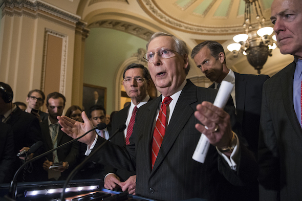 "Senate Majority Leader Mitch McConnell,  r-Ky., joined by from left, Sen. John Barrasso, R-Wyo., Sen. John Thune, R-S.D., and Majority Whip John Cornyn, R-Texas, faces reporters' questions on controversial statements by GOP presidential candidate Donald Trump at a news conference following a closed-door policy meeting at the Capitol in Washington, Tuesday, June 7, 2016. McConnell called on his party's presumptive nominee to quit scrapping with various minority groups and ""get on message"" in order to win the White House.    (AP Photo/J. Scott Applewhite)"