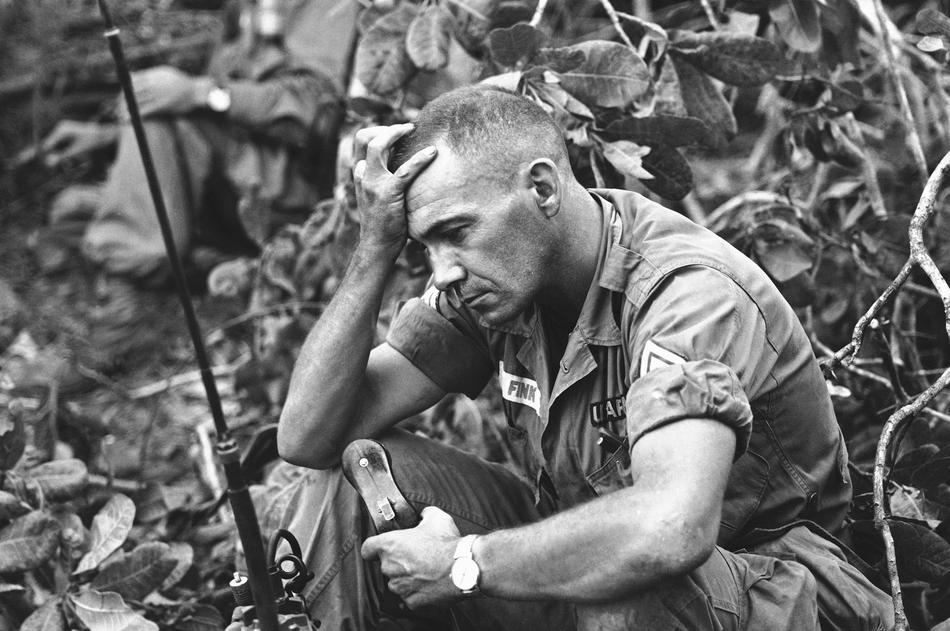 The strain of battle for Dong Xoai is shown on the face of U.S. Army Sgt. Philip Fink, an advisor to the 52nd Vietnamese Ranger battalion, shown June 12, 1965. The unit bore the brunt of recapturing the jungle outpost from the Viet Cong. (AP Photo/Steve Stibbens)
